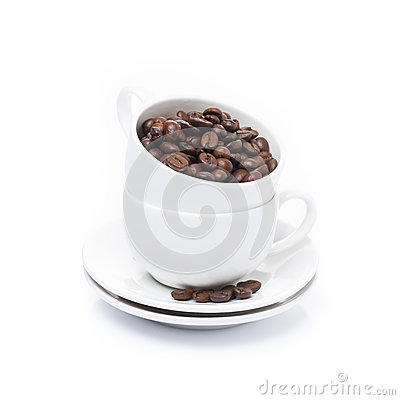 White cup with coffee beans, isolated