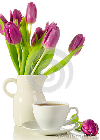 White cup of coffee with bunch of purple tulips  on whit