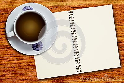 White cup of coffee and notebook