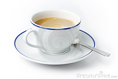 White cup of coffee on plate with spoon