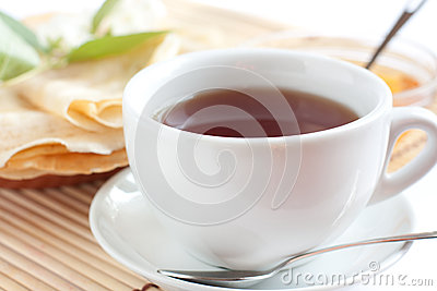 White cup of fragrant tea