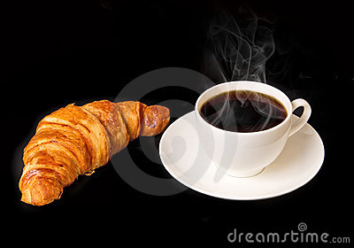 White cup of hot coffee with french croissant