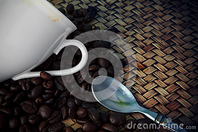 White cup of hot coffee and tea spoon with fresh c