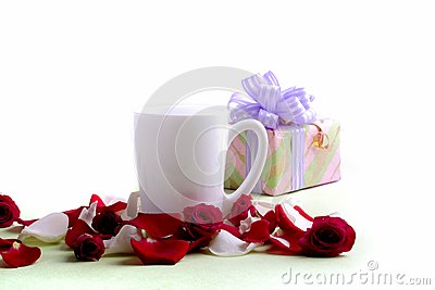 White cup and rose petals and heads