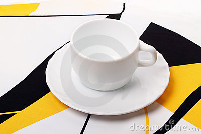 White cup on the tablecloth