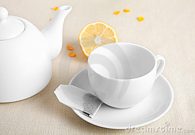 White cup with tea ba