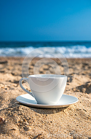 Free White Cup With Tea Or Coffee On Sand Beach Front Of Sea Stock Image - 43811921