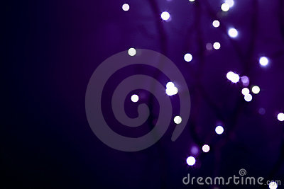 White defocused lights on dark violet background