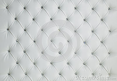 WHITE DIAMOND STUDDED PADDED LUXURY LEATHER BACKGROUND