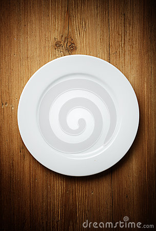 White Dinner Plate on Wood
