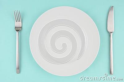 White dishes on aqua tablecloth
