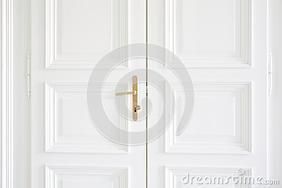 White doors with golden handle inside