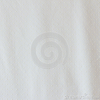 White dots on white fabric texture