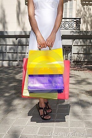 White dressed hands woman holding shopping bags