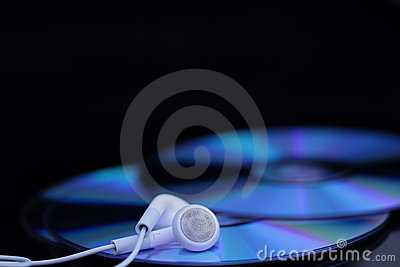 White ear phones on CDs