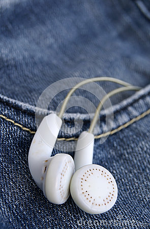 White earphones in denim jeans pocket