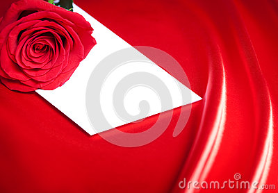 White envelope and red rose