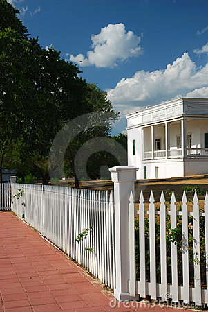 White fence and house