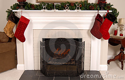 White fireplace decorated for Christmas