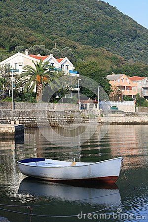 Free White Fishing Boat Near The Village Stoliv In Montenegro. Stock Photo - 45366280