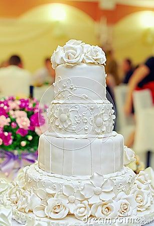 White floral wedding cake on restaurant background