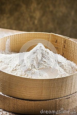 White flour on a sieve