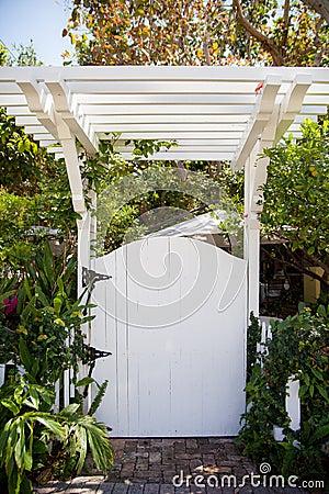 White gate and pergola