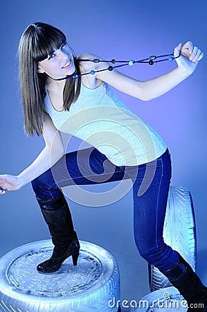 White girl posing on tyres