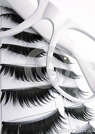 White Glasses and False Eyelashes