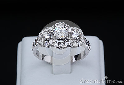 White gold diamond ring with stand