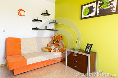 White and green bedroom with orange sofa