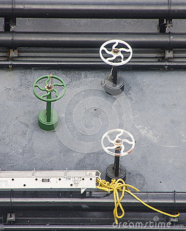 White and Green Valves on Black Barge