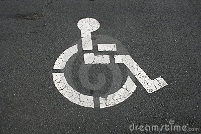 White Handicapped Symbol On Pavement