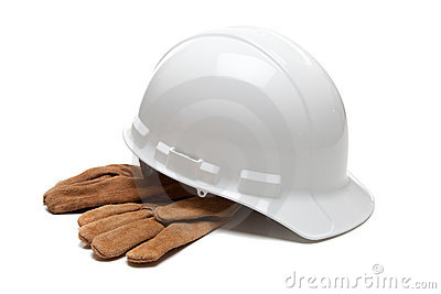 White hard hat and leather work gloves on white
