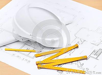 White hard hat near working tools