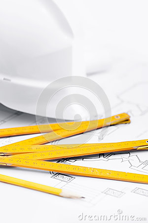 White hard hat near working tools, close up