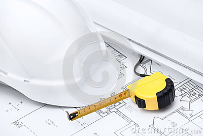 White hard hat and tape measure
