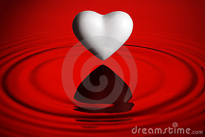 White heart over water ripples