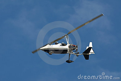 white helicopter flying