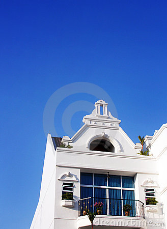 White house, blue tropical sky