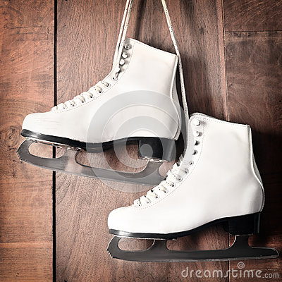 Free White Ice Skates For Figure Skating, Hanging On Wooden Background Stock Images - 78733694