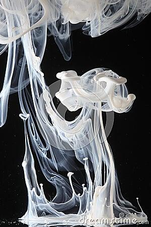 White ink swirls in water