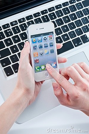 White iphone 4 in women s hands Editorial Stock Photo