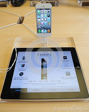 White iPhone 5 in Apple store Editorial Stock Image