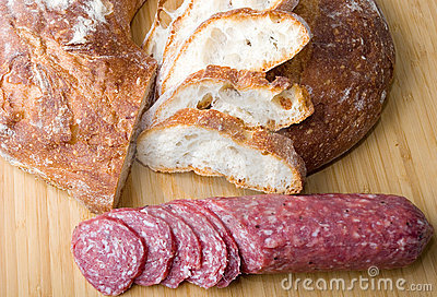 White Italian bread sliced with sausage sandwich