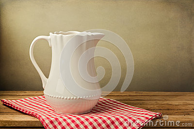 White jug on tablecloth