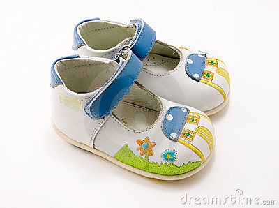 White kid s shoes with hook-and-loop, isolated