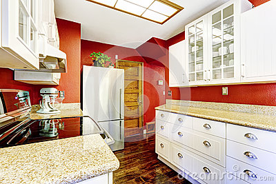 White kitchen room with contrast bright red walls stock for Bright red kitchen cabinets