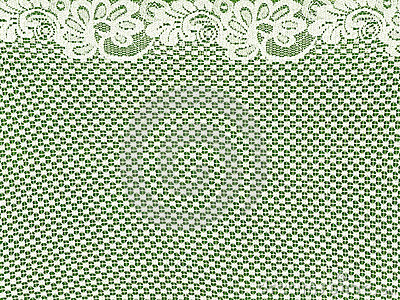 White lace border on green background