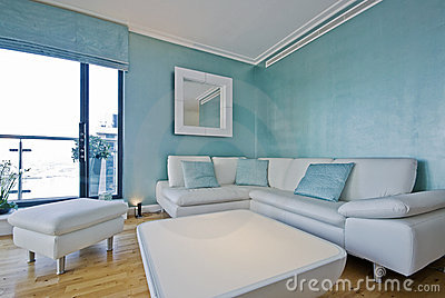 White leather corner sofa in a modern living room
